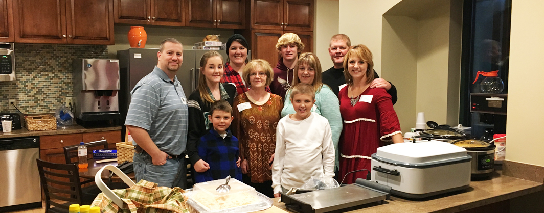 Volunteers serving dinner in Ronald McDonald House kitchen