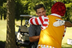 Trent Green embraces Ronald McDonald at Trent Green Golf Classic
