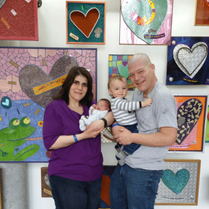 The Martin family posing in front of the heart wall
