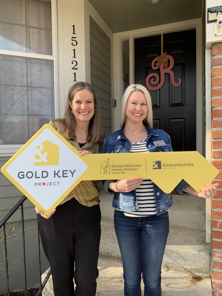 Tami and Wendy Sprately with a large gold key